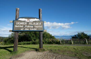 Homer Alaska Sign looking over the Kachemak Bay